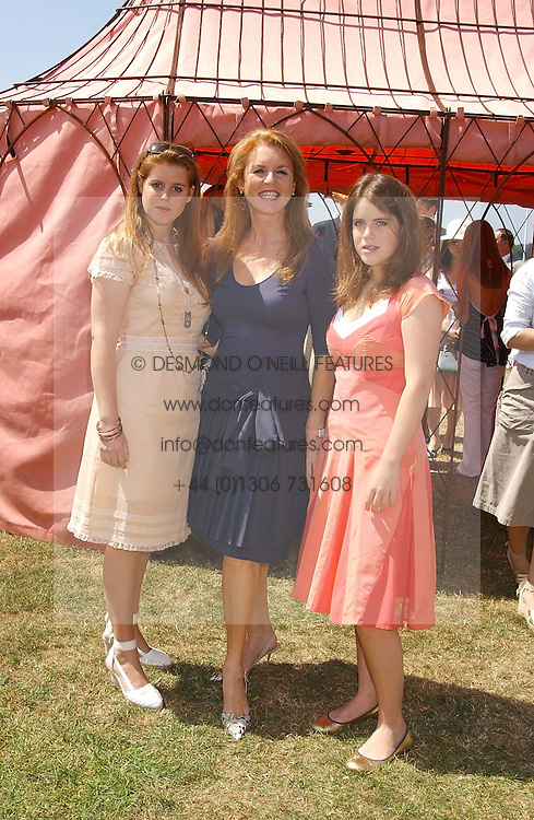Left to right, HRH PRINCESS BEATICE OF YORK, SARAH, DUCHESS OF YORK and HRH PRINCESS EUGENIE OF YORK at the Veuve Clicquot sponsored Gold Cup Final or the British Open Polo Championship held at Cowdray Park, West Sussex on 17th July 2005.<br />