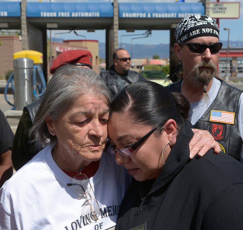 gbs040917e/ASEC -- Slain motorcyclist Earl Roybal as Roybal's  Aunt, Rita Nunez-Gallegos, center, hugs his daughter, Ashley Roybal at a press conference seeking answers from police at the cash wash were he was killed on Sunday, April 9, 2017. (Greg Sorber/Albuquerque Journal)
