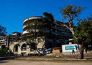 "Beira Grande Hotel,  Hell with 5 Stars <br /> <br /> Built in 1954, the Beira Grande Hotel was once the most luxurious hotel in Africa The giant  complex had around 120 suites, a cinema, an Olympic swimming pool, a helicopter pad,  restaurants, a bank, a post office - it was a city in itself. Since shutting down, this colonial <br /> dream has become a nightmare. After being used initially as military <br /> base during the civil war, the squatters moved in. Thousands of impoverished people now crowd the Grande Hotel, it being the only place they can find shelter. The living conditions are atrocious. <br /> Drugs, disease, and trash are ubiquitous. People have removed much<br /> of the plumbing, electrical, windows and even concrete to sell on the black market. This weakens the building but provides them with another meal. The parquet floor was used as fuel for cooking, so all <br /> that is left now is the cold, unwelcoming structure they call home. Children play around open elevator shafts with no elevator in sight. <br /> ""No one knows when the building is going to collapse,<br /> "" says one resident, Its going to collapse on top of our poverty""<br /> Despite the abhorrent conditions, there is an element on community here. All are poor, but poor together. Newcomers are always welcome and mutual respect is one of the few laws in this house of misery. <br /> It was really the pinnacle of luxury, meant for wealthy businessmen and tourists. For its massive size, 120 rooms is really not much. Turns out there was no demand so they shut it down in 1963. It never made a profit.  After closing, the pool still remained open. The Mozambican Olympic Swimming Team trained there. Now it used by inhabitants for bathing or washing laundry. After the civil war, it became a refugee camp. The people who live there have mostly emigrated from the mine-filled countryside.  As of 2008, it housed 1,077 inhabitants with large families sharing one room. Now there is between 2,000 and 3,000 inhabitants about 350 families. They occupy not only the rooms <br />"