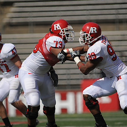 Apr 18, 2009; Piscataway, NJ, USA; Rutgers OL Desmond Stapleton (73) blocks DE Jonathan Freeny (99) during the second half of Rutgers' Scarlet and White spring football scrimmage.
