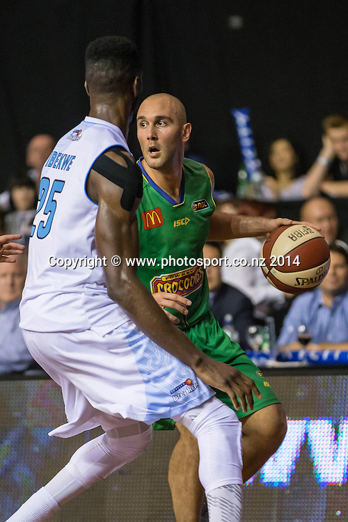 Crocodiles' Steven Markovic is challenged by Breakers` Ekene Ibekwe in the game between SkyCity Breakers v Townsville Crocodiles. 2014/15 ANBL Basketball Season. North Shore Events Centre, Auckland, New Zealand, Friday, December 19, 2014. Photo: David Rowland/Photosport