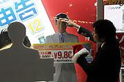 businessman sales clerks working on a window display