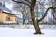 Traditional typical houses on Barrugata with snow on the ground in the old town area of capital city Reykjavik, Iceland