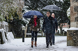 © Licensed to London News Pictures. 10/12/2017. Reading, UK.  Theresa May and her husband Philip May attend church in heavy snow.  Photo credit: Peter Macdiarmid/LNP