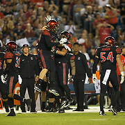 08 October 2016: The San Diego State Aztecs football team open's up the mountain west conference season at home against the University of Nevada Las Vegas Rebels. San Diego State linebackers Austin Wyatt-Thayer (43) and Ronley Lakalaka (39) celebrate after Wyatt-Thayer's sack. The Aztecs beat the Rebels 26-7 to improve to 4-1 and 1-0 in conference play. www.sdsuaztecphotos.com