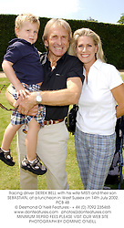 Racing driver DEREK BELL with his wife MISTI and their son SEBASTIAN, at a luncheon in West Sussex on 14th July 2002.	PCB 48