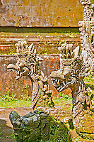 Two stone carved dragons at Pura Kehen Temple near Bangli in Eastern Bali Indonesia