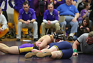 Alburnett's Dylan Windfield (top) tries to pin Regina's Cam Lynch during the 160-pound bout in the Class 1A Wrestling Regional semifinals between Alburnett and Iowa City Regina at Alburnett High School in Alburnett on Tuesday, February 5, 2013. Windfield defeated Lynch with a fall. (Stephen Mally/Freelance)
