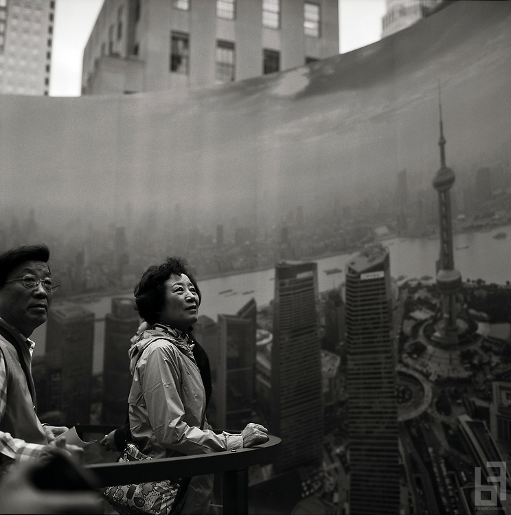 "Woman viewing a 360 degree panorama of the city of Shanghai in Midtown Manhattan.  Taken from the series ""Down with the Ship"""