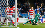 everybody watches as the ball crosses the line despite Mitchell Lund goal line cover during the Sky Bet League 1 match between Gillingham and Doncaster Rovers at the MEMS Priestfield Stadium, Gillingham, England on 5 September 2015. Photo by Andy Walter.