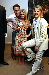 Left to right, actor NICK PICKARD, actress NICOLA STAPLETON and PHIL HUNT at an exhibition of photographs entitled 'Hispanic in Hollywood' at Jaeger's Flagship store 200 Regent Street, London on 30th August 2006.<br /><br />NON EXCLUSIVE - WORLD RIGHTS