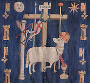 Tapestry of Agnus Dei or the Lamb of God, with the instruments of the Passion, and a background of towers and keys, late 15th century, in Les Hospices de Beaune, or Hotel-Dieu de Beaune, a charitable almshouse and hospital for the poor, built 1443-57 by Flemish architect Jacques Wiscrer, and founded by Nicolas Rolin, chancellor of Burgundy, and his wife Guigone de Salins, in Beaune, Cote d'Or, Burgundy, France. The hospital was run by the nuns of the order of Les Soeurs Hospitalieres de Beaune, and remained a hospital until the 1970s. The building now houses the Musee de l'Histoire de la Medecine, or Museum of the History of Medicine, and is listed as a historic monument. Picture by Manuel Cohen