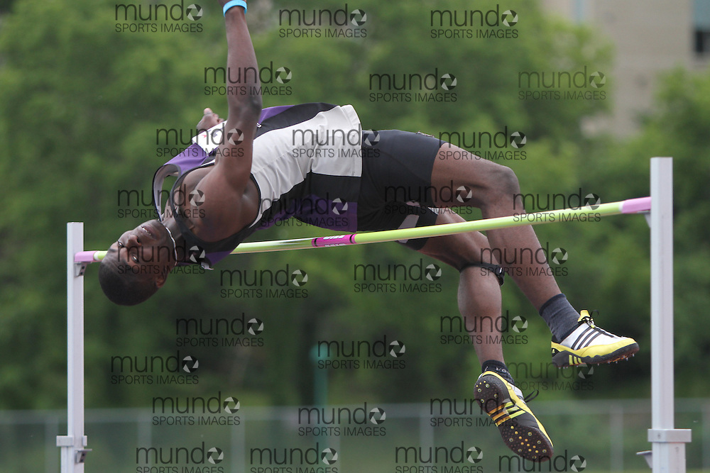 (London, Ontario}---04 June 2010) Charles Akomolafe of Harold M Brathwaite - Brampton competing in the high jump at the 2010 OFSAA Ontario High School Track and Field Championships in London, Ontario,  June 04, 2010. Photograph copyright Laura Barclay / Mundo Sport Images, 2010.