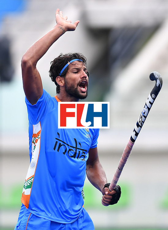 India's Rupinder Pal Singh reacts during the mens's field hockey India vs Canada match of the Rio 2016 Olympics Games at the Olympic Hockey Centre in Rio de Janeiro on August, 12 2016. / AFP / MANAN VATSYAYANA        (Photo credit should read MANAN VATSYAYANA/AFP/Getty Images)