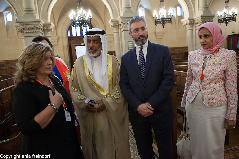France, Paris, &quot;This is Bahrain&quot; religious freedom delegation visits the Synagogue. (R ) Afnan Rashid Al Zayani, ctivist and multi-million-dollar company CEO and president of Al Zayani Commercial Services, Rabbi Moshe Sebbag, Muslim cleric Sheikh Salah bin Yousuf Aljowder, Betsy B.Mathieson, Secretary General of Bahrain Federation of Expatraite Associations . &quot;This is Bahrain&quot;, delegation, a multi-faith group of Bahrainis and expatriates, set up to highlight religious tolerance in Bahrain and promote understanding between cultures and faiths, is the brainchild of the Bahrain Federation of Expatriate Associations (BFEA).<br /> Paris, FRANCE - 16/06/2015.