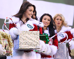 Dec 24, 2011; East Rutherford, NJ, USA; Members of the New York Jets flight team holds a Christmas present during the first half of their game against the New York Giants at MetLife Stadium.