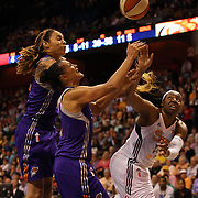 Kelsey Bone, (right), Connecticut Sun, challenges for a rebound with Mistie Bass and Brittney Griner, Phoenix Mercury, during the Connecticut Sun Vs Phoenix Mercury WNBA regular season game at Mohegan Sun Arena, Uncasville, Connecticut, USA. 23rd May 2014. Photo Tim Clayton