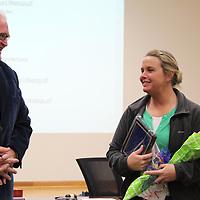 Aberdeen School Board President Jim Edwards congratulates Elizabeth Oliver for being named Aberdeen High School Teacher of the Year.
