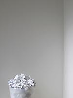 Wastebasket Full of Crumpled Paper