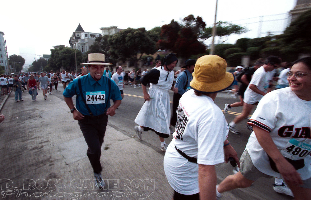 The Amish are coming, the Amish are coming!  Men dressed as Amish men and women crest the Hayes Street hill during the 90th running of the Bay to Breakers, Sunday, May 20, 2001 in San Francisco. (Photo by D. Ross Cameron)
