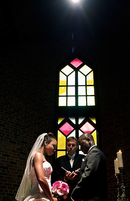 A lone spotlight hangs overhead during the beautiful Wedding Ceremony.