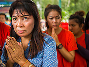 31 AUGUST 2014 - SARIKA, NAKHON NAYOK, THAILAND: Women pray at the Ganesh festival at Shri Utthayan Ganesha Temple in Sarika, Nakhon Nayok. Ganesh Chaturthi, also known as Vinayaka Chaturthi, is a Hindu festival dedicated to Lord Ganesh. It is a 10-day festival marking the birthday of Ganesh, who is widely worshiped for his auspicious beginnings. Ganesh is the patron of arts and sciences, the deity of intellect and wisdom -- identified by his elephant head. The holiday is celebrated for 10 days, in 2014, most Hindu temples will submerge their Ganesh shrines and deities on September 7. Wat Utthaya Ganesh in Nakhon Nayok province, is a Buddhist temple that venerates Ganesh, who is popular with Thai Buddhists. The temple draws both Buddhists and Hindus and celebrates the Ganesh holiday a week ahead of most other places.    PHOTO BY JACK KURTZ