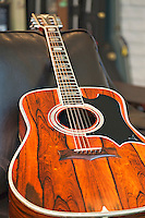 Close-up view of acoustic guitar lying on sofa in music store