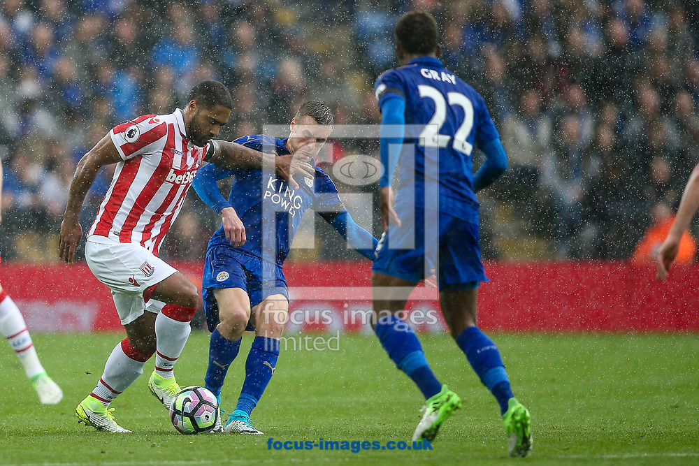 Glen Johnson of Stoke City (left) competing with Jamie Vardy of Leicester City (centre) during the Premier League match at the King Power Stadium, Leicester<br /> Picture by Andy Kearns/Focus Images Ltd 0781 864 4264<br /> 01/04/2017