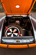 Image of a blue/orange 1967 911S Porsche sports car trunk with spare tire in Utah, American Southwest
