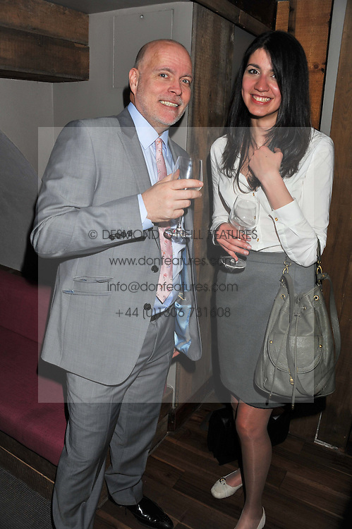 GARY GOLDSMITH the uncle of the Duchess of Cambridge and ELIF KUTSAL at a party to celebrate the publication of A History of Food in 100 Recipes by William Sitwell held at Archer street, 3-4 Archer Street, London W1 on 11th April 2012.