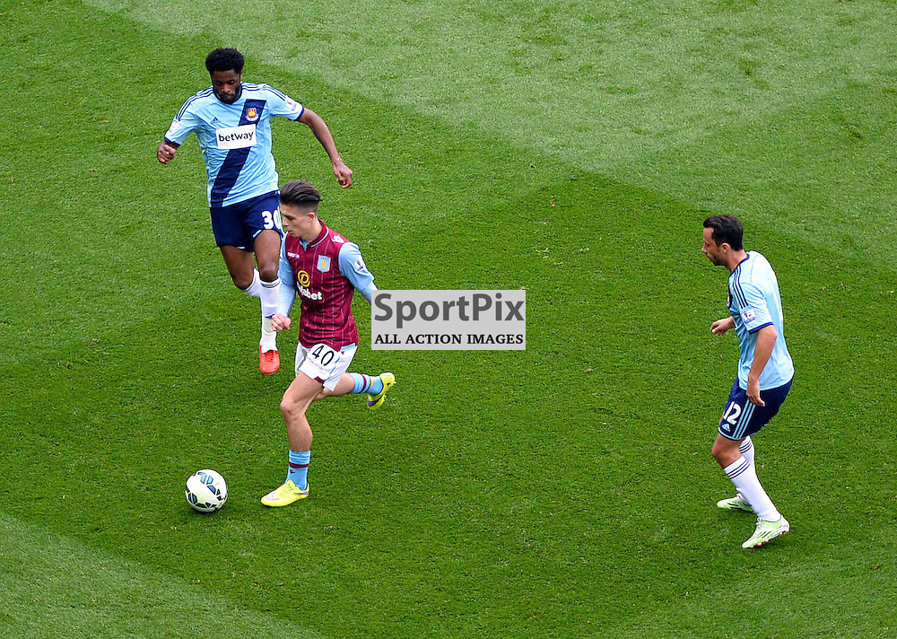 Jack Grealish is closely watch by West Ham players Alex Song and Nene