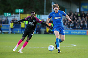 AFC Wimbledon defender Mads Bech Sorensen (26) battles for possession with Peterborough United attacker Mohamed Eisa (7) during the EFL Sky Bet League 1 match between AFC Wimbledon and Peterborough United at the Cherry Red Records Stadium, Kingston, England on 18 January 2020.