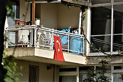 April 18, 2018 - Ankara, Turkey - A Turkish flag is seen on a balcony in Ankara on April 18, 2018. Turkey's President Recep Tayyip Erdogan announced plans on April 18 to bring forward the November 2019 presidential and parliamentary elections to June 24, 2018. (Credit Image: © Altan Gocher/NurPhoto via ZUMA Press)