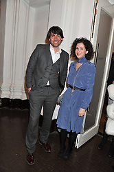 ALEX JAMES and MOLLIE DENT-BROCKLEHURST at the launch of the Krug Happiness Exhibition at The Royal Academy, 6 Burlington Gardens, London on 12th December 2011.