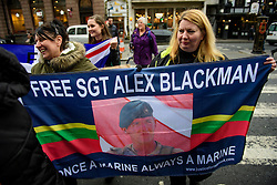 © Licensed to London News Pictures. 21/12/2016. London, UK. Supporters of Sgt Blackman gather outside the Royal Courts of Justice in London to show support for Royal Marine Sergeant Alexander Blackman at his bail hearing. Sgt Blackman is currently serving a life sentence after being convicted of murdering a wounded Taliban fighter in Afghanistan in 2011. Photo credit: Ben Cawthra/LNP