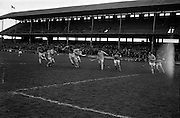 05/04/1964<br /> 04/05/1964<br /> 5 April 1964<br /> National Hurling League Semi-Final: Laoghis v Antrim at Croke Park, Dublin.<br /> C. O'Brien (Laoghis) still manages to beat Antrim backs, Gallagher and McNeil, despite losing his stick in the tussle.