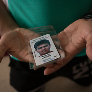 PALM SPRINGS, FLORIDA, JANUARY 14, 2018<br /> Refugee camp ID belonging to Mamudul Hasson, 21, in the bedroom where he sleeps next to  his uncle in his house. Hassan is a Rohingya Muslim refugee who just arrived to the United States three weeks ago.<br /> (Photo by Angel Valentin/Freelance)