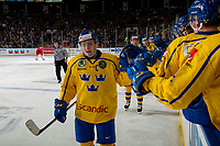KELOWNA, BC - DECEMBER 18:  Erik Brännström #12 of Team Sweden first bumps the bench to celebrate a goal against the Team Russia at Prospera Place on December 18, 2018 in Kelowna, Canada. (Photo by Marissa Baecker/Getty Images)***Local Caption***