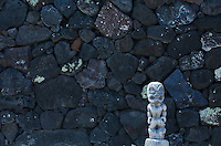 Small Ki'i gaurdian in front of a stone wall at Pu'uhonua o Honaunau National Historical Park, Place of Refuge