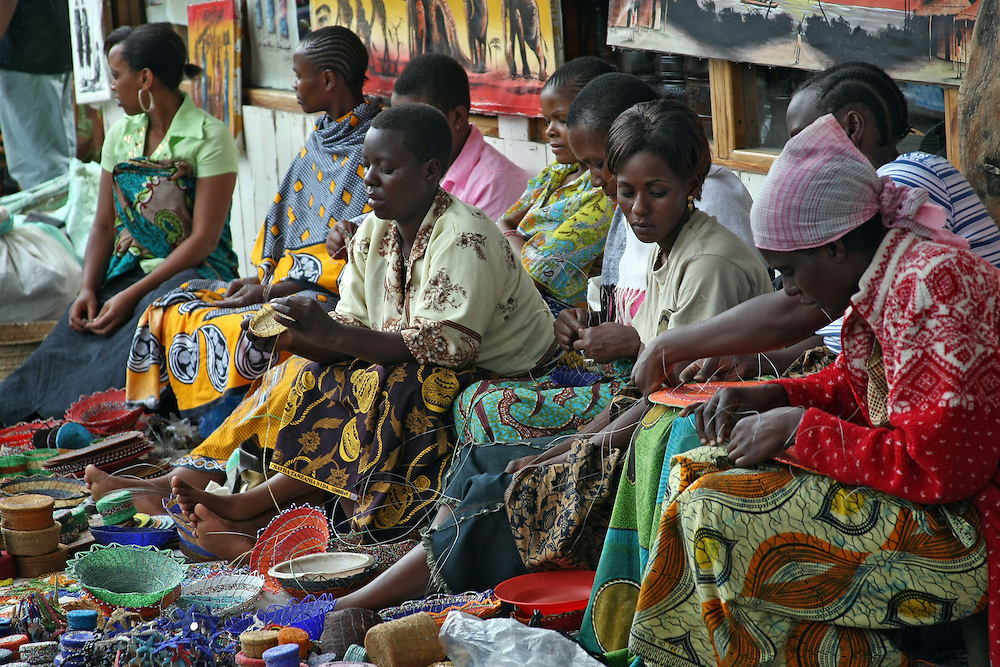 Tanzanian women at a popular marketplace selling their handmade merchandise.