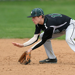 Staff photos by Tom Kelly IV<br /> Ridley second baseman Michael Naumann (11) fields a ground ball during the Ridley at Strath Haven baseball game on Thursday afternoon.