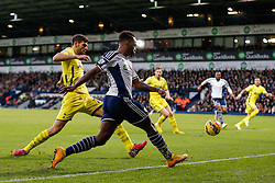 Saido Berahino of West Brom crosses the ball in as Federico Fazio of Tottenham Hotspur challenges - Photo mandatory by-line: Rogan Thomson/JMP - 07966 386802 - 31/01/2015 - SPORT - FOOTBALL - West Bromwich, England - The Hawthorns - West Bromwich Albion v Tottenham Hotspur - Barclays Premier League.