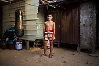 A portrait of Boonsong Samrong outside of his home and gym in Rayong, Thailand.