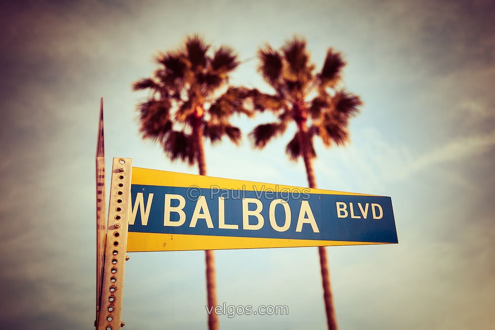 Balboa Boulevard street sign Newport Beach photo. Picture is vintage toned to give 1970s look. Balboa Blvd is located on Balboa Peninsula in Newport Beach California. Newport Beach is a beach community along the Pacific Ocean in Orange County California.