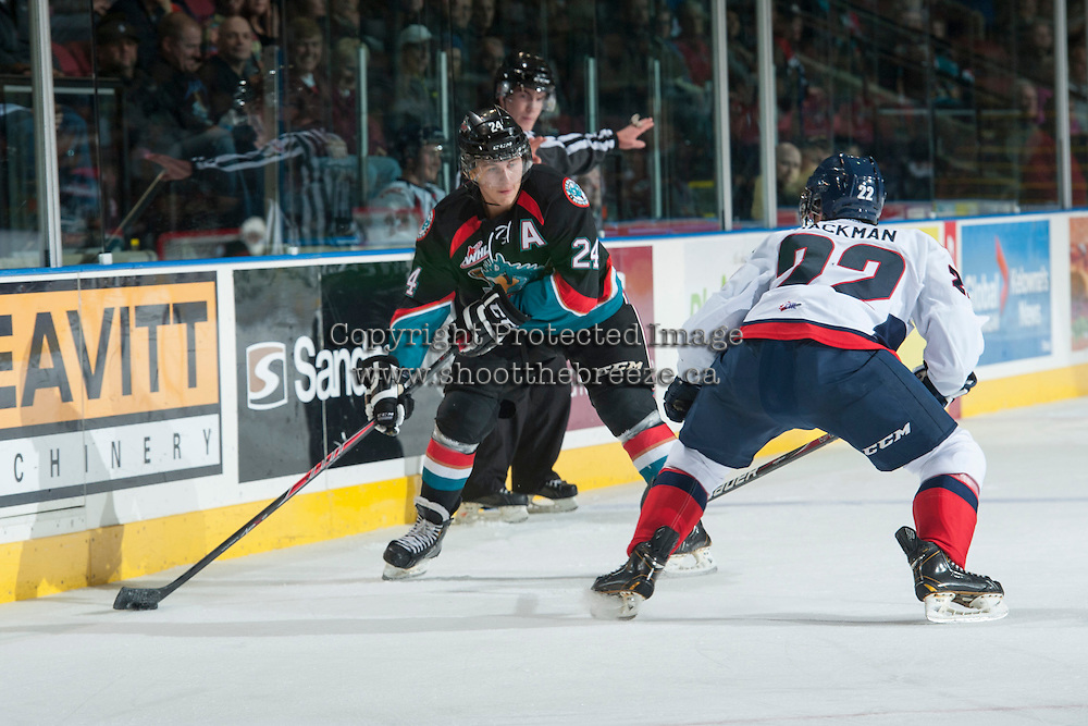 KELOWNA, CANADA, OCTOBER 16 -  Tyson Baillie #24 of the Kelowna Rockets looks for the pass against the Lethbridge Hurricanes on Wednesday, October 16, 2013 at Prospera Place in Kelowna, British Columbia (photo by Marissa Baecker/Getty Images)***Local Caption***