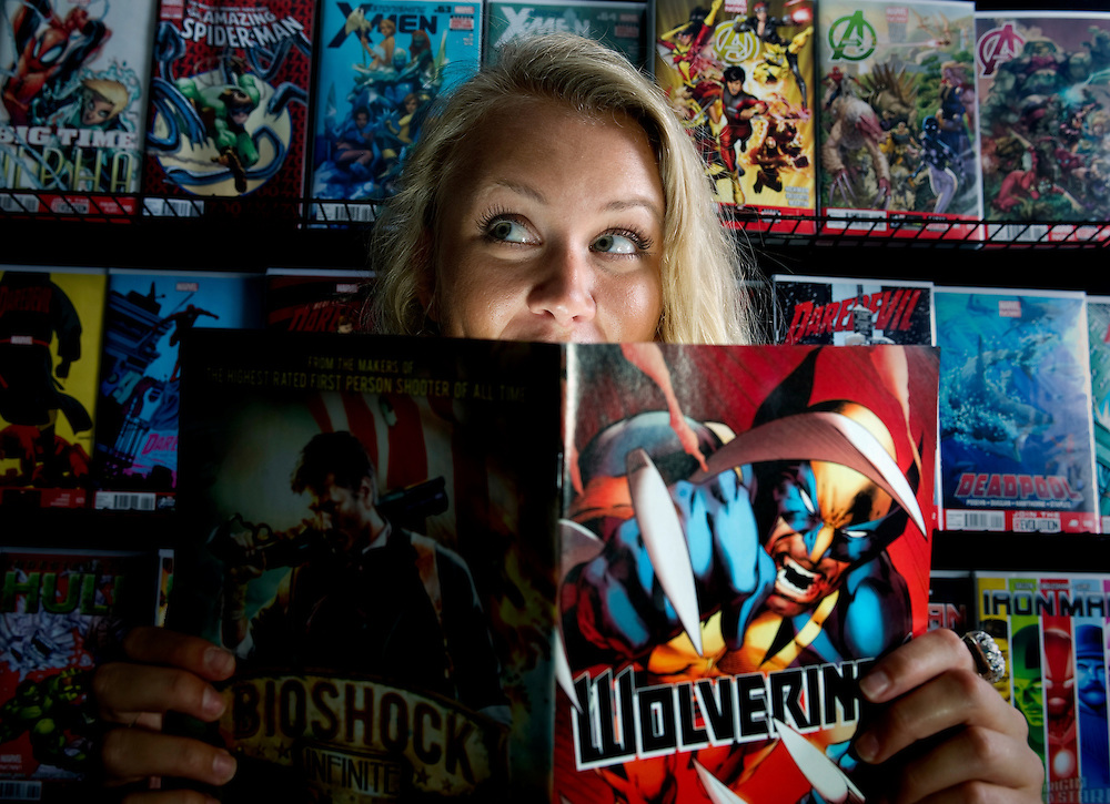 Hali Hasenstab poses for a photograph while holding a Wolverine comic book at Hereos' Haven comic book shop Wedensday, July 17, 2013 in Tampa.