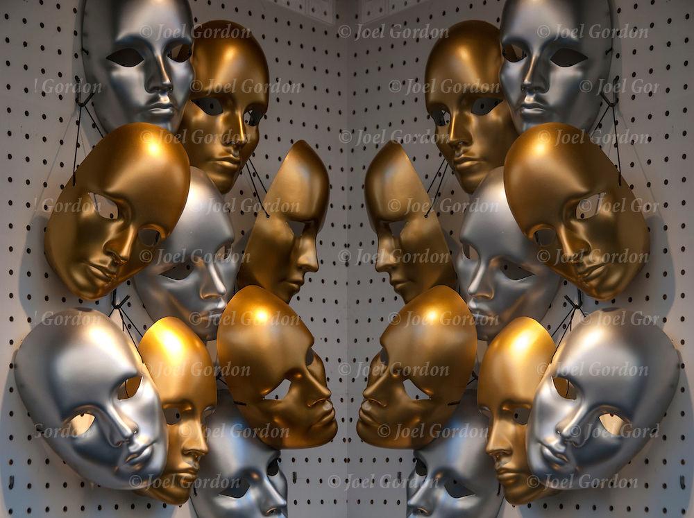 Diptych of image flipped of display of golden - copper and silver color masks in store window.