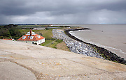 House at risk from coastal erosion, East Lane, Bawdsey, Suffolk, England