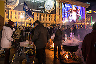 KIEV, UKRAINE - DECEMBER 3: Protesters cook meals for other demonstrators during an ongoing anti-government rally in Independence Square on December 3, 2013 in Kiev, Ukraine. Thousands of people have been protesting against the government since a decision by Ukrainian president Viktor Yanukovych to suspend a trade and partnership agreement with the European Union in favor of incentives from Russia. (Photo by Brendan Hoffman/Getty Images) *** Local Caption ***