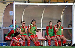 NEWPORT, WALES - Tuesday, June 12, 2018: Wales substitutes on the bench during the FIFA Women's World Cup 2019 Qualifying Round Group 1 match between Wales and Russia at Newport Stadium. Elise Hughes, goalkeeper Claire Skinner, Hannah Miles, Gemma Evans, Kylie Nolan and Alice Griffiths. (Pic by David Rawcliffe/Propaganda)